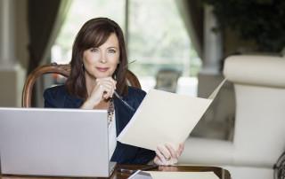 women female financial advisor looking at paper
